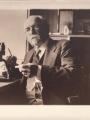 Carlos de la Torre y Huerta at a microscope   Smithsonian Institution Archives, Carlos de la Torre y Huerta, Record Unit 7089, Bartsch, Paul, 1871-1960, Paul Bartsch Papers, Box 16